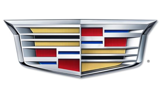 The new crest retains the iconic shape and geometric grid from the original Cadillac family 'coat of arms'.
