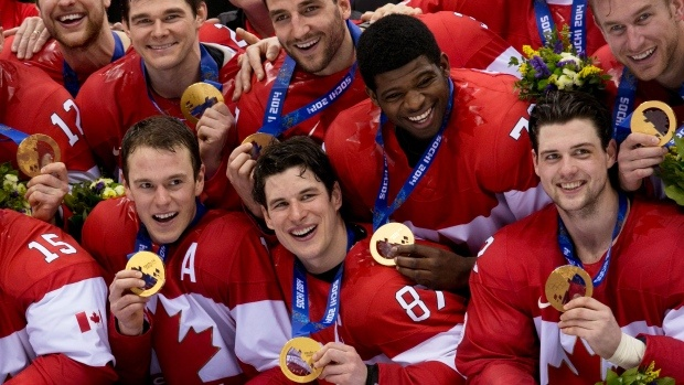 Members of the Canadian Men's Olympic team pose with their new Gold medals.