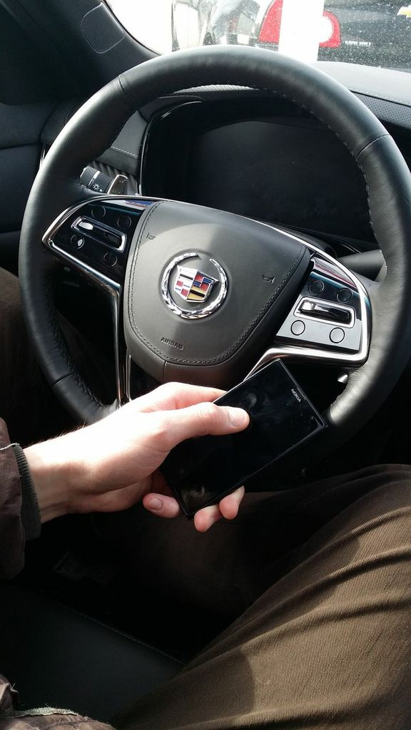 Don't drive distracted! Instead, call your contact with your Bluetooth equipped car and phone. Or, pull off the road for a quick sec!